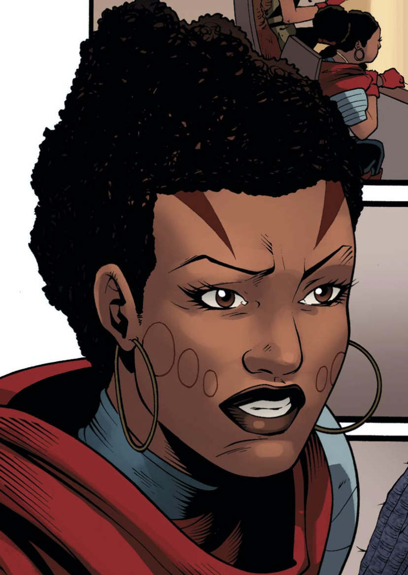A close-up on Aneka's face with traditional Wakandan face tattoos and hoop earrings.