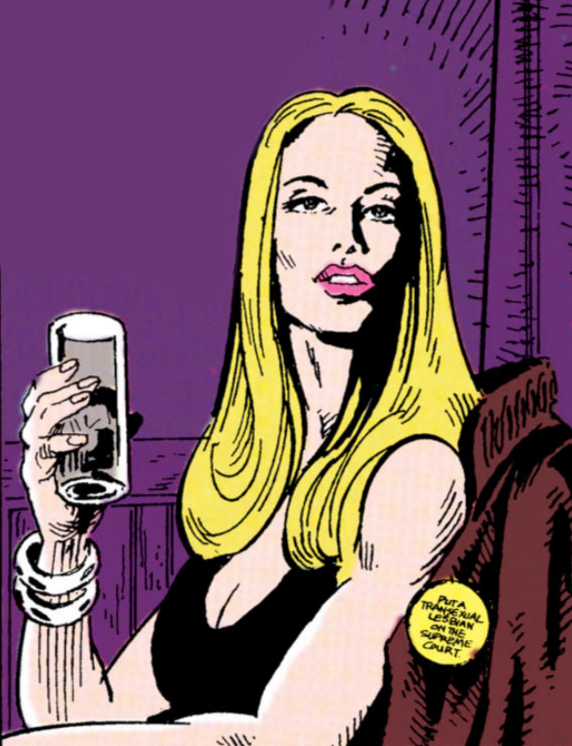 "Kate Godwin, a transgender character in Doom Patrol, is depicted drinking a highball. Her jacket boasts a button that reads ""Put a transexual lesbian on the Supreme Court."""